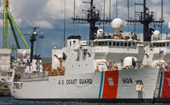 Daytime view of two U.S. Coast Guard cutters docked side by side in Baltimore