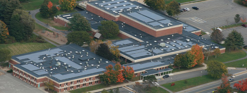 Aerial view of a Newburyport, Massachusetts school with solar panels on its roof