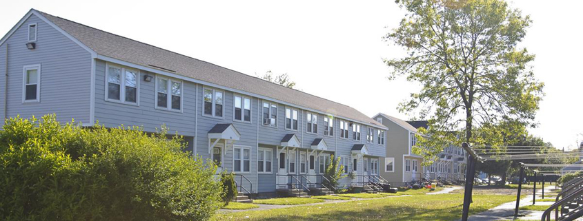 Daytime exterior of a row of houses owned by the Lynn, Massachusetts Public Housing Authority
