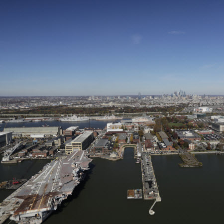 Daytime aerial view of Philadelphia Navy Yard with docks in the foreground