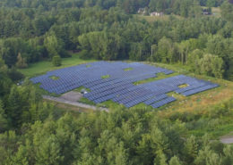 Daytime aerial view of a brownfield solar farm in Stockbridge, Massachusetts.