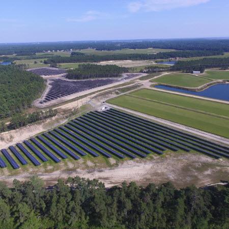 Photo Credit: © BlueWave Solar (www.bluewavesolar.com) - Aerial view of a solar farm in Wareham, Massachusetts