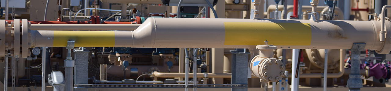 Daytime close up view of piping in a renewable natural gas plant
