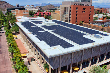 Daytime view of solar panels on the roof of a building on the Arizona State University campus