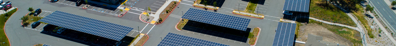 Daytime aerial view of solar canopies in a parking lot