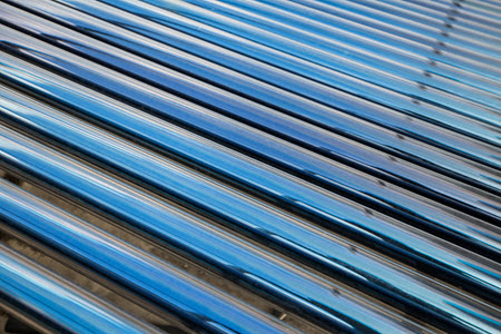 Daytime close up view of solar thermal heating tubes