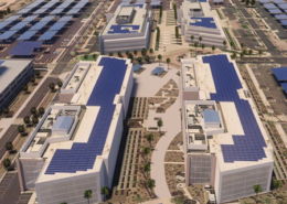 A daytime aerial view of a corporate campus in Chandler with renderings of rooftop solar panels and solar canopies added